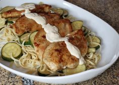 Chicken and zucchini are simply cooked and served with garlic cream sauce. A great chicken recipe made with a simple list of ingredients.