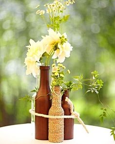 Wine Bottle Centerpiece - wrap in camel twine, and tie each with a charcoal ribbon
