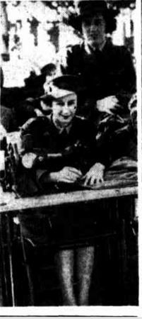 1943 Private M Cordiner (Maryborough) and M Cowan (Blackall) of the AWAS