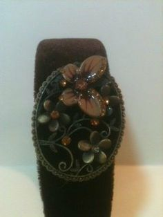 Brown Velvet Headband with Oval Decrotive Flower And Butterflies with Rhinestone Accents . $12.99. Brown Velvet Headband with Oval Decrotive Flower And Butterflies with Rhinestone Accents