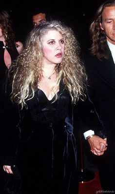 Stevie ~ ☆♥❤♥☆ ~    straining to see and holding hands with her escort as they attended a pre-Grammy party in 1995
