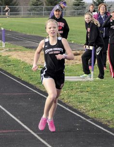 Brooke Rennick finishing the 3200 meter run with her teammates and coach/dad Bob…