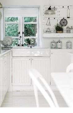 white french nordic country style kitchen with window above farmhouse sink