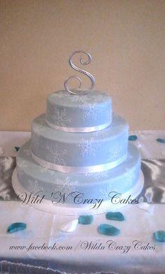 Elegant snowflake wedding cake