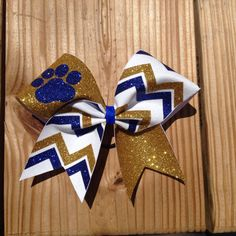 paw print cheer bow by BragAboutItCheerBows on Etsy, $16.00