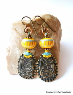 Elegant artisan bronze and lampwork glass earrings with an ancient tribal atmosphere, by Two Trees Studio.