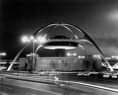 A 1960s Theme Building at LAX illuminated at night.