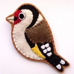 Felt bird... It's a brooch, but I think it would make an awesome Christmas decoration or gift.