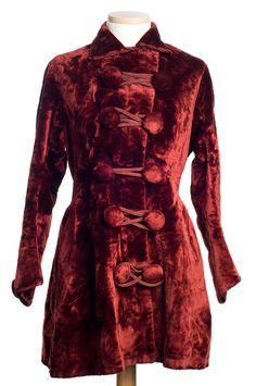 Maroon velvet jacket, 1910s The large covered buttons joined by corded loops form the decorative element for this luxurious coat. It was worn by Hesse Pringle Alston, daughter of Jacob Motte Alston of Charleston.Courtesy of the Charleston Museum.