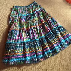 TRAVELSMITH skirt...NWOT Colorful crinkle fiesta skirt,excellent for travel, has a hidden pocket, can wear many different tops to change your look, comes w/a pouch, NEW....NEVER WORN. TravelSmith Skirts Maxi