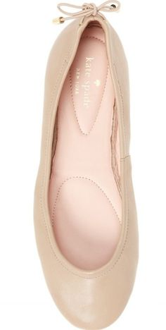 An elastic topline and a rounded toe ensure an effortless fit in this foldable Kate Spade ballet flat finished with a metal-tipped bow at the heel.