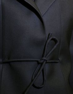 Style - Minimal + Classic: Simple, beautifully cut black jacket.  Detailed and tied with the simplest of bows.  Perfect!