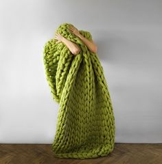 Anna Mo's chunky knits are not shy about their pattern, the soft form of her objects forcing the wearer to observe the pieces in all of their magnified glory. To knit these mammoth material works the Ukraine-based Mo not only uses extremely thick sections of wool, but also XXL needles to pr