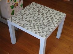 how to tile a table top. I wonder if I could do this on our tv trays that always end up being used as side tables.