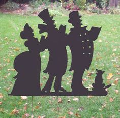 """Carolers Silhouette Garden Stake. This custom designed Christmas Caroling Silhouette will become a holiday favorite in any yard. A charming way to add some fun to your holiday decor. Overall size is 36"""" high by 39"""" wide. Included are 3-42"""" stakes attached. Before you purchase you can contact me to change the color or size. Custom orders are always welcome! With any questions please contact us at k.t@rusticaornamentals.com or 860-778-6841."""