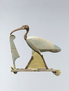 Inlay depicting Thoth as the ibis with a maat feather - Late Period–Ptolemaic Period, 4th century B.C. Geography: From Hermopolis (el-Ashmunein) - Faience, polychrome
