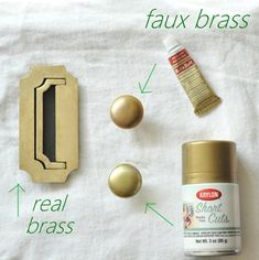 Real brass drawer pull next to faux-brass knobs.  One with Krylon Gold Metallic spray paint, the other with Rub'nBuff Gold Leaf paste.