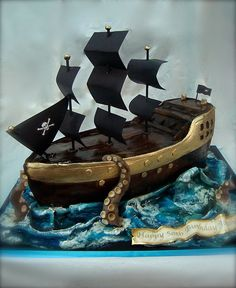pirate ship/kraken attack cake by debbiedoescakes, via Flickr