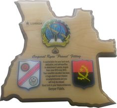 """Marine Corps Embassy Security Group Plaque  The """"Angola Embassy"""" plaque is wood veneered country shaped plaque with colored sub-laminated medallions and coated with thick, durable epoxy. We can do similar plaques in the shape of states or other countries, prices vary based on the size and number of medallions. Plaque measures 12"""" x 12"""".  Contact me through Facebook at www.facebook.com/collectablewoods or email at bmwelch@collectablewoods.com."""