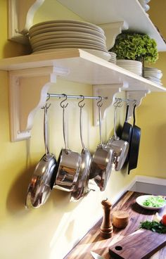 Pan storage idea lids will slide on handles so you can find the right lid to any pot.