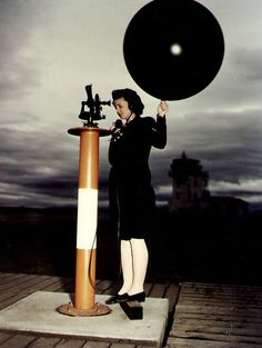 WAVES Aerographer's Mate 3rd Class Dorothy J. Baroch launching a weather balloon rom a theodolite platform, Naval Air Station, Moffett Field, California, United States, circa 1944-1945