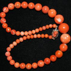 Beautiful vintage coral necklace!  Gorgeous orange coral beads that are large and natural.