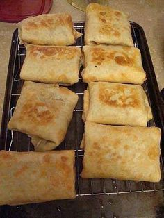 """Baked Chicken Chimichangas  8oz pkg. cream cheese 8oz. Pepperjack cheese, shredded 1 1/2 Tbsp. taco seasoning 1 lb. cooked chicken, shredded 8 flour tortillas cooking spray Stir together cheeses and seasoning. Fold in chicken. Divide among flour tortillas. Tuck in sides, and roll up each tortilla. Lay seam side down in a sprayed 9x13"""" baking dish. Spray tops of tortillas with cooking spray. Bake at 350 for 15 minutes. Turn chimi's over, and bake an additional 15 minutes."""