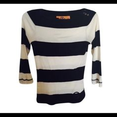 Tory Burch black and white striped top Black and white striped Tory burch knit top.  Tory burch insignia at waist and on buttons at shoulder.  Very minor staining as depicted in third picture which is not noticeable! Tory Burch Tops