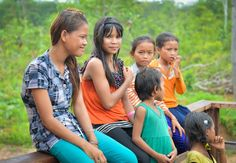 Group of school grils on a fence Dor Village Cambodia