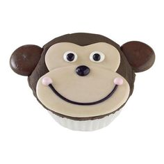 Monkey Munchie Cupcakes - This cute little chimp comes to life with easy-melting Candy Melts®! Ice cupcake smooth; attach easy-to-make candy plaque muzzle and ears. The Monkey Munchie Cupcakes are more fun than a barrel of monkeys.