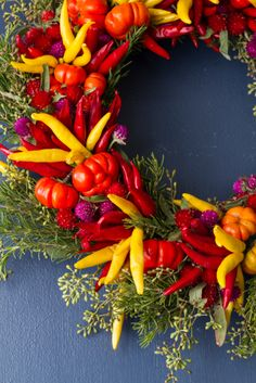 Handmade holiday wreaths using yellow, orange and red chili peppers, mini pumpkins, clover, rosemary, eucalyptus, straw flowers and more. All grown on the farm. Colors will vary with the season. $40