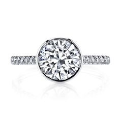 ALICIA is a handcrafted Jean Dousset Diamonds solitaire engagement ring - JeanDousset.com - shown with a Round Brilliant cut diamond in Platinum. #rounddiamond #roundcut #engagementring