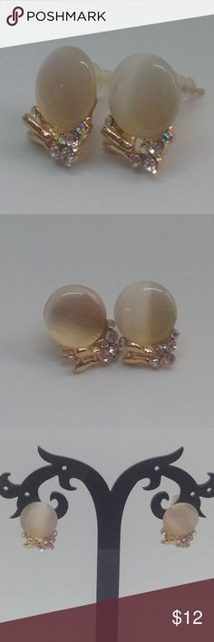 Spring Style Earrings Beautiful earrings! These are one of my favored! Have a very pretty design with a butterfly on the bottom. Also with fake diamonds. Very pretty earrings! Trendy Rose Jewelry Earrings
