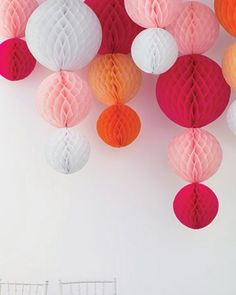 Paper lanterns strung vertically from the ceiling...