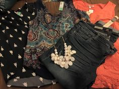My latest Stitch Fix box...love how my stylist pays attention to my Pinterest board...the tulip tank was a pin on my board as a long sleeve version...she sent what was appropriate for the season!