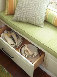Window seats are great for #storage! Here, extra china is kept safe in large pull-out drawers.