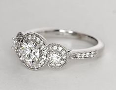 Three Stone Milgrain Halo Diamond Engagement Ring in 14k White Gold (1/2 ct. tw.) | Blue Nile