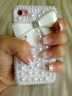 White pearl nails and white pearl phone case
