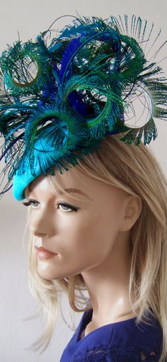 Turquoise Blues and Green Fascinator Peacock & Pheasant Headpiece Hat. Almond Shaped Beret Base, with dozens of curled peacock ostrich and pheasant feathers. Great mother of the bride, fashions on the field racing fashion, Royal Ascot, Kentucky Derby, Spring Carnival Oaks Day or guest of friend wedding hat. in Lagoon Turquoise, Royal Blue and Greens. #fashion #fashionsonthefield #fascinator #headpieces #racingfashion #dress2impress #royalascot #kentuckyderby #melbournecup #derbyday