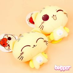 These super soft and cute neko mini plushies will make you smile! The plush comes with a metal chain and a suction cup, so you can attach it to your bag, keys or even a window. The plushies are made from soft stretch Lycra, and filled with light small Styrofoam balls. There is also a cute sticker!
