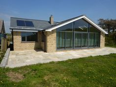 This dining/garden room extension has full height glazing facing south. All the windows have been replaced in aluminium, with the. Bungalow Extension Plans, Bungalow Floor Plans, House Extension Design, Bungalow Renovation, Roof Extension, Bungalow Ideas, Extension Ideas, Small Bungalow, Modern Bungalow House