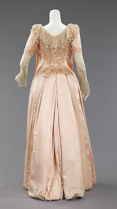 1885 silk This tea gown, with light corseting and bustle is a more fashionable adaptation of the Aesthetic style. An unusually early, and quite beautiful, it is made in their distinctive light and supple silks.