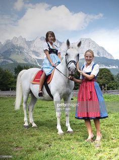 Peaches Geldof sits on a lipizzan horse held by Maria Hauser at the Stanglwirt Hotel on August 23, 2010 in Going, Austria. IT-Girl Peaches, daughter of singer Bob Geldof, came to Tyrol for a photo session at the Bio-Hotel Stanglwirt. The traditional dress of owner Maria Hauser fascinated her and she wanted to wear for this picture on a white lipizzan horse in front of the 'Wilder Kaiser' mountain the traditional 'Weisswurst-Party' Dirndl.  |  S❤