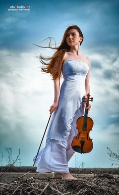 The red-haired girl with a violin outdoor by Andriy Petrenko, via 500px