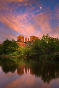 The moon rises above Cathedral Rock and it's reflection in Oak Creek, Crescent Moon Ranch, Sedona, Arizona. Photo: Adam Schallau.