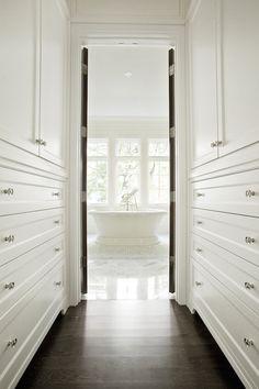 walk through closet between bedroom and bathroom