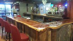 A barn wood bar with a cedar slab top featuring a live edge I built for a restaurant  -  Barn Wood Furniture Union Grove, Alabama