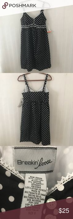 Breakin Loose Polka Dot Sundress NWT Breakin Loose Black with white polka dot sundress. Bodice is lined with white fabric and has white lace rickrack it. Also, 3 Buttons as decorations. Very cute, 60s vibe. Armpit to armpit is 17 inches  Back length is 30 inches. Breakin Loose Dresses Midi