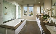 The master bath features a double shower, soaking tub, dual sinks and a large, walk-in closet. - Residence 1X at The Estates at Del Sur in San Diego, CA