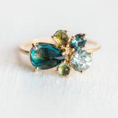 Green gemstone cluster ring
